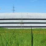 Die Halle des SLS am Paul Scherrer Institut in der Schweiz sieht ein bischen aus wie ein Stapel Pfannkuchen.